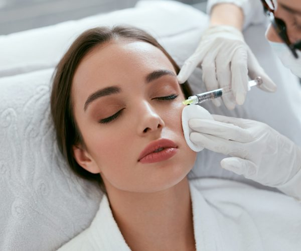Cosmetology Procedure. Woman Receiving Face Skin Lift Injections Around Eyes. High Resolution
